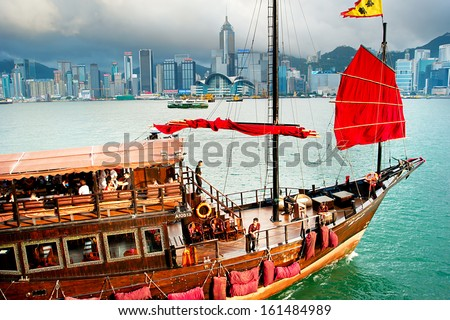 HONG KONG - MAY 18: Traditional chinese-style tourist junk sailing in Hong Kong harbor on May 18, 2013. Overall visitor arrivals to Hong Kong in 2012 totalled just over 38 million - stock photo