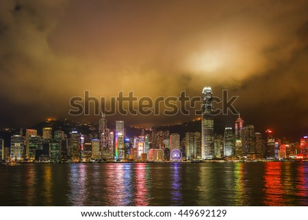 Hong Kong night view  with reflections of light on the cloud at victoria harbor