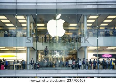 HONG KONG - NOV 08, 2014:A busy Apple Store in Hong Kong located inside IFC shopping mall, Hong Kong. - stock photo