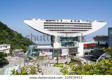 HONG KONG - NOV 15, 2014: The Peak Tower in Hong Kong with many tourists. The Peak Tower  is one of the most popular spot among tourist visiting Hong Kong. - stock photo