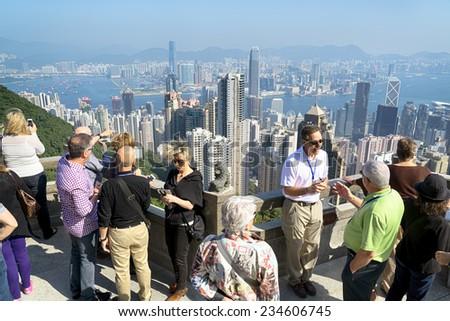 HONG KONG - NOV 15, 2014: Tourists at Victoria Peak in Hong Kong. Victoria Peak is one of the most popular spot among tourist visiting Hong Kong. - stock photo