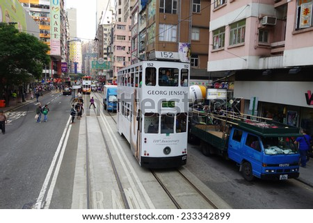 HONG KONG - NOV 21: Unidentified people using city tram in Hong Kong on November 21, 2014. Tram is the only system in the world run with double deckers and one of the main tourist attractions. - stock photo