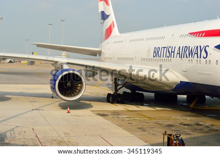 HONG KONG - NOVEMBER 22, 2015: British Airways A380 docked in Hong Kong Airport. British Airways, often shortened to BA, is the flag carrier airline of the United Kingdom. - stock photo