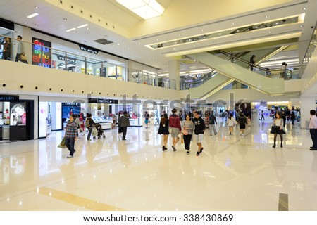 HONG KONG - NOVEMBER 02, 2015: interior of New Town Plaza. New Town Plaza is a shopping mall in the town centre of Sha Tin in Hong Kong. Developed by Sun Hung Kai Properties - stock photo