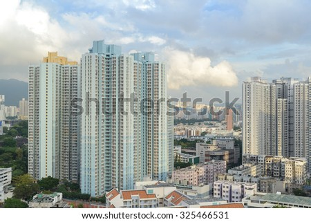 HONG KONG - OCT 8, 2015: Aerial view of Sham Shui Po district. With a population of seven million people, Hong Kong is one of the most densely populated areas in the world. - stock photo