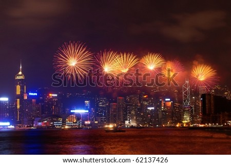 HONG KONG - OCT 1 : Fireworks for celebration of  Chinese national day at the Victoria Harbor on Oct 01, 2010 in Hong Kong, China - stock photo