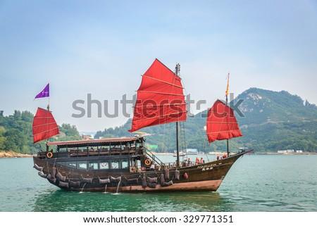 Hong Kong - OCT 20, 2015: Hong Kong Victoria Harbour on October 20 in Hong Kong. Aqua Luna is popular tourist attraction in Hong Kong. - stock photo