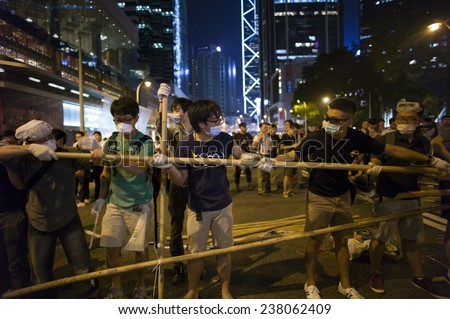 HONG KONG - OCT 15: People are building bamboo barricades in the middle of the road in Admiralty during Occupy Central in Hong Kong on October 15 2014.  - stock photo