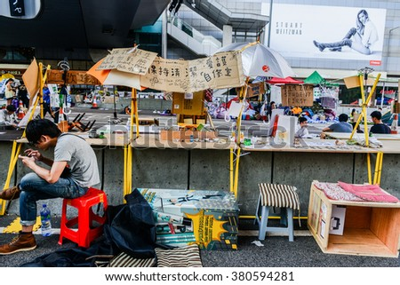 HONG KONG, OCT:students study on the street while occupy protest is insisted in Admiralty during umbrella revolution. People setup a study room for students. - stock photo
