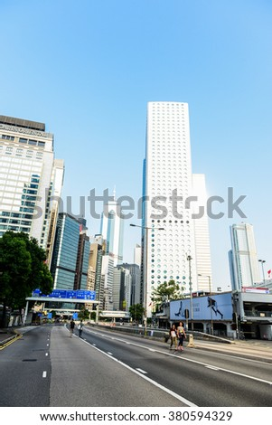 HONG KONG, OCT 2014: Two women walking on city during umbrella revolution - stock photo
