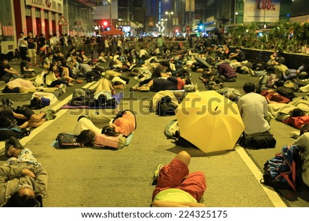 HONG KONG, OCT.17: young protesters sleep on the street in Mong Kok on 17 October 2014. during Umbrella revolution, police clear the roadblock, but one day after protester occupy the road again - stock photo