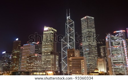 HONG KONG - OCTOBER 4: Highrise office buildings at night on October 4, 2010 in Hong Kong. Bank of China and HSBC buildings are amongst famous in the world. - stock photo
