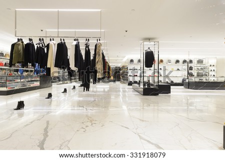 HONG KONG - OCTOBER 25, 2015: interior of Saint Laurent store. Saint Laurent Paris is a luxury fashion house founded by Yves Saint Laurent and his partner, Pierre Berge - stock photo