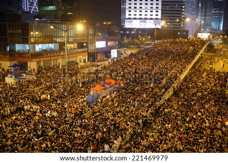HONG KONG - October 4, 2014: Many of protesters continue to occupy the road in Central business area on October 4, 2014. After the violence visited the peaceful protesters on October 3 in Mong Kok. - stock photo