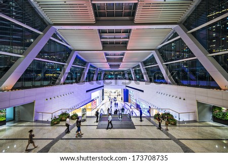 HONG KONG - OCTOBER 9, 2012: Pedestrians pass through the International Commerce Building public lobby. The building is the tallest in the city.