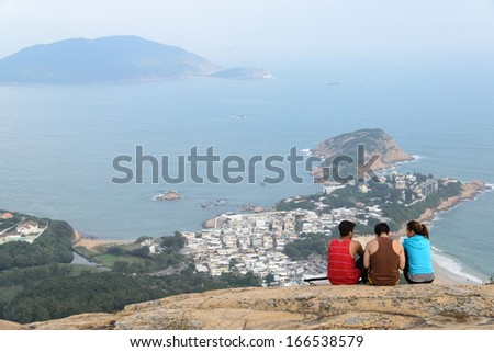 HONG KONG - OCTOBER 8 : Trekker are sitting on the mountain along the way of Dragon Back trail in Hong Kong on October 8, 2013. Dragon back trail in one of the most famous trekking trail in Hong Kong