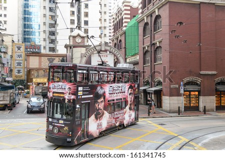 HONG KONG - OCTOBER 18: Unidentified people using city tram in Hong Kong on October 18, 2013. Hong Kong tram is the only in the world run with double deckers and one of the main tourist attractions.