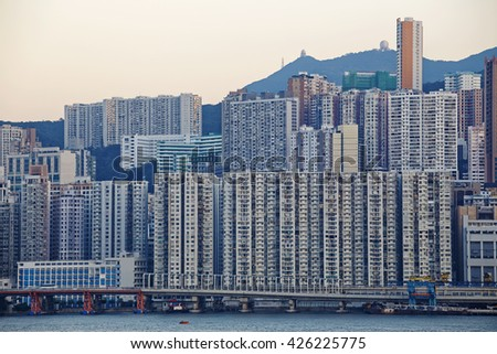 Hong Kong public house buildings in sunset - stock photo