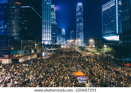 HONG KONG, SEPT 30: Crowd of protesters occupy the road in Admiralty on 30 September 2014. Hong Kong people are fighting for a real universal suffrage for the next chief executive election. - stock photo