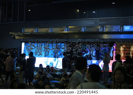 HONG KONG, SEPT.29: Crowd of protesters show the banner in Admiralty on 29 September 2014. after riot police fire tear shell to the peaceful protesters on 28 sept, more people join the protest