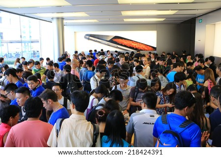 HONG KONG, SEPT. 20: New launch of Apple iPhone six plus are surround by people in Central IFC apple store on 20 September 2014. Hong kong is one of region where the iPhone 6 1st round launching. - stock photo
