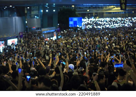 HONG KONG, SEPT.29: protesters raise up the mobiles in Admiralty government headquarters on 29 Sept. 2014. after riot police fire tear shell to the peaceful protesters on 28 sept, protester increase - stock photo