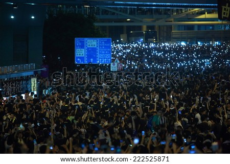 HONG KONG, SEPT.29: protesters wave the mobiles in Admiralty on 29 September 2014. after riot police fire tear shell to the peaceful protesters on 28 sept, more people join the protest - stock photo