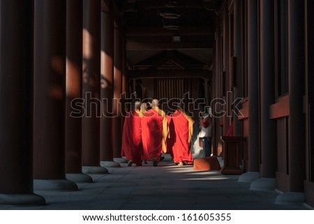 Hong Kong - September 03, 2012 : Buddhist monks praying on evening religion ceremony in temple - stock photo