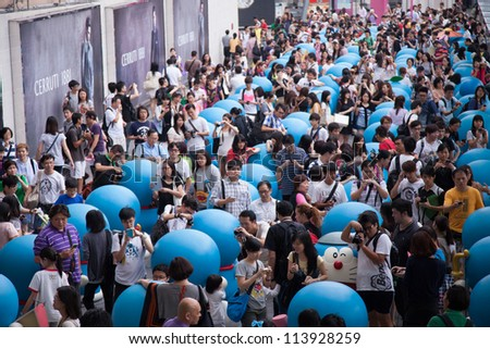 HONG KONG - SEPTEMBER 14: Hong Kong largest Doraemon Exhibition at Harbour city, Hong Kong on September 14, 2012. It is the early celebration of Doraemon's birth 100 years early. - stock photo