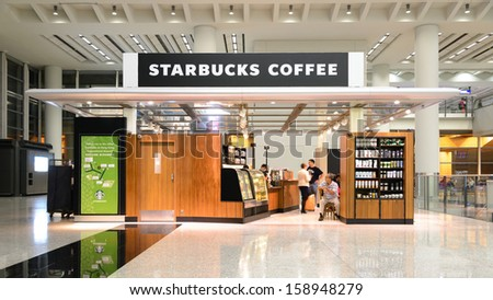HONG KONG- SEPTEMBER 8: Starbucks Coffee coffeehouse on September 8, 2013 in Hong Kong. Starbucks is the largest coffeehouse company in the world, with 19,435 stores in 58 countries (2012). - stock photo