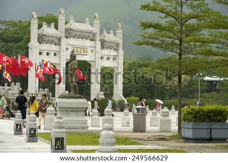 HONG KONG - September 25: statue and gateway on the approach to Po Lin buddhist monastery, where Big Buddha is located, Lantau Island on September 25, 2013 in Hong Kong, China - stock photo