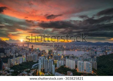 Hong kong sky with sunset - stock photo
