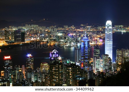 Hong Kong skyline at night. Thousand of skyscraper on two side of Victoria Harbour of Hong Kong.  View from the Peak at night. - stock photo