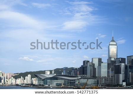 Hong Kong skyline at sunset over Victoria harbor - stock photo