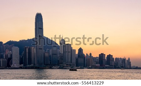 Hong Kong skyline at sunset with dusk sky