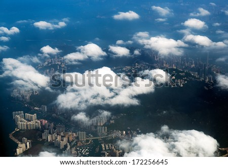 hong kong skyline, view from a flying airplane. - stock photo