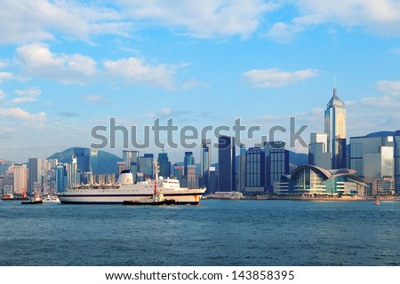 Hong Kong skyline with boats in Victoria Harbor. - stock photo