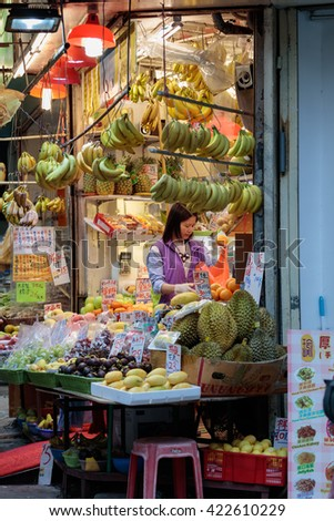Hong Kong, Special Administrative Region of the People's Republic of China - 19 April 2016: Young woman selling fruits on traditional asian market