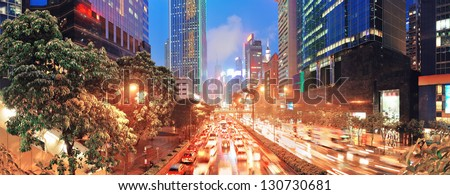 Hong Kong street panorama with busy traffic and skyscraper office at dusk. - stock photo