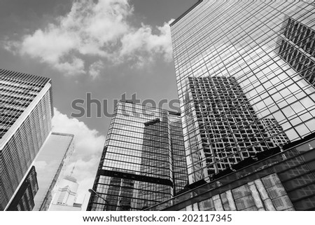 Hong Kong street scenery with high buildings under sky, Asia.
