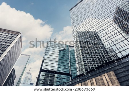 Hong Kong street scenery with high buildings under sky, Asia. - stock photo