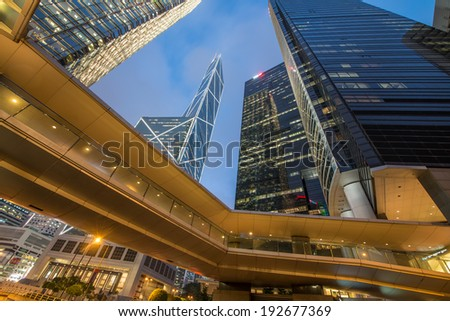 Hong Kong streetscape at night. Pedestrian passage and tall skyscrapers in Central - stock photo