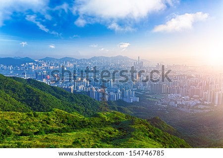 hong kong sunrise on mountain - stock photo