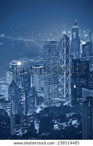 Hong Kong. Toned image of Hong Kong with many skyscrapers at night. - stock photo