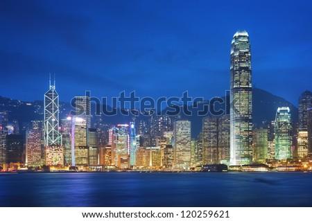 Hong Kong, Victoria Harbor at night. - stock photo