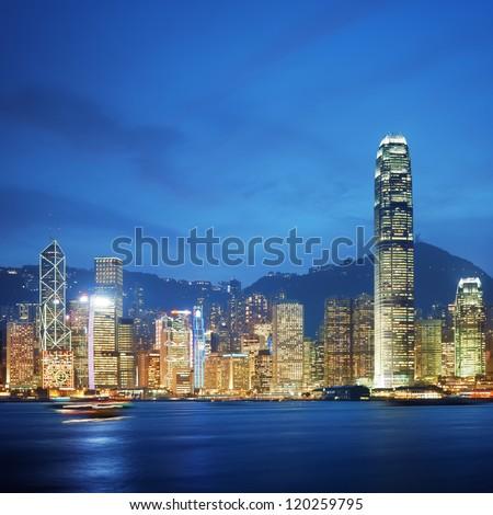 Hong Kong, Victoria Harbour at night. - stock photo