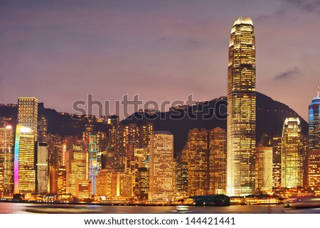 HONG KONG,  view on the city skyscrapers with advertisin lights. - stock photo
