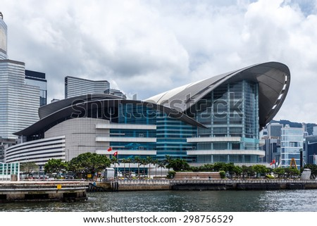 Hongkong,China-June 13,2015:Exterior of Hong kong conference and exhibition center and skyline. - stock photo