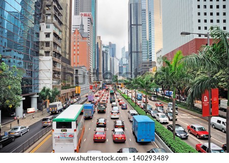 HONGKONG, CHINA-MAY 30:  Gloucester road, traffic and city life in this Asia international business and financial center. This is one of the most populated area in the world. May 30, 2008 Hong Kong - stock photo