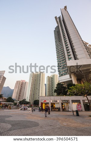 HONGKONG - FEBRUARY 22, 2016: The large building and people around the Citygate outlets hall with golden sunlight before sunset time.